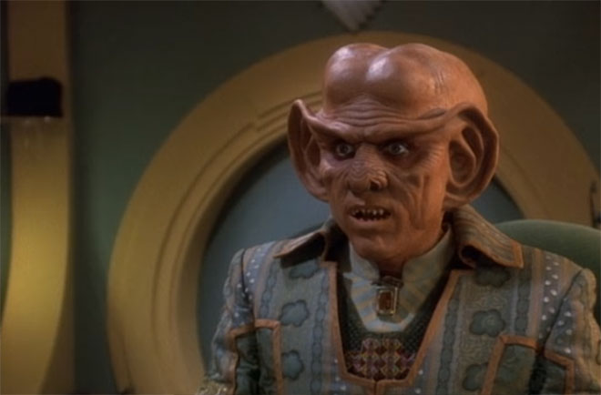Quark, with more of those weird Ferengi towels lurking behind him.